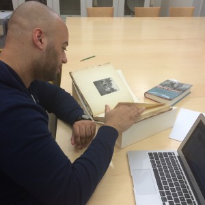 David Polanco looks through the 1905 Bryn Mawr yearbook (photo by Monica Mercado)