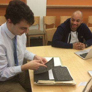 Temple University students Matt Cahill and David Polanco compare findings in the Special Collections seminar room, November 2014.